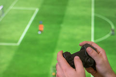 Man Holding game controller joystick while playing console game. Stock Photography