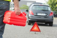 Man holding gasoline canister stock photos