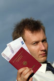 Man holding german pass with money Stock Image