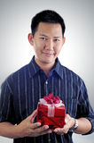 Man holding a gift Stock Images