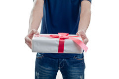 Man holding a gift box. In a gesture of giving Royalty Free Stock Photos