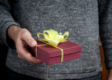 Man holding a gift. Box Royalty Free Stock Image