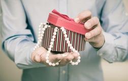 Man holding a gift box Stock Photo