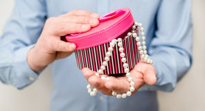 Man holding a gift box. In the form of heart Royalty Free Stock Photography