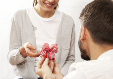 Man holding gift box and giving girlfriend. Man holding gift box and  giving girlfriend Royalty Free Stock Photo