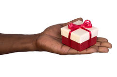 Man holding a gift box in hand Stock Photos