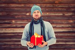 Man holding gift box in hands. Handsome unshaven man holding gift box in hands. holiday present. Valentines Day Stock Photo