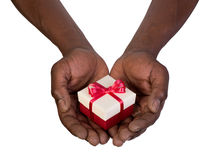 Man holding a gift box in hands. Isolated on white background Stock Image