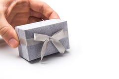 Man holding gift box. Isolated on white background Royalty Free Stock Photos