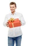 Man holding gift box. Studio shot. Valentine`s Day. Man holding gift box Stock Photos