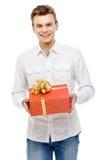 Man holding gift box. Studio shot. Valentine`s Day. Man holding gift box Stock Images
