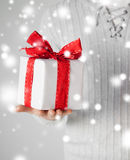 Man holding a gift box. Valentine's day, christmas, x-mas, winter, happiness concept - man holding a gift box Royalty Free Stock Photography