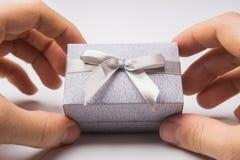 Man holding gift box on white background Royalty Free Stock Image