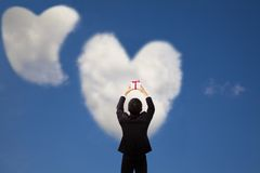 Man holding gift and cloud  love Royalty Free Stock Photo