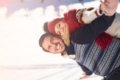 Man holding girlfriend on his back at the top of mountain Royalty Free Stock Photography