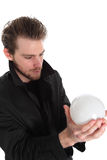 Man holding a glass ball Stock Image