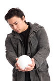 Man holding a glass ball Royalty Free Stock Images