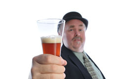 Man holding glass of beer Royalty Free Stock Photos