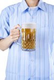 A man holding a glass of beer Royalty Free Stock Image