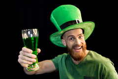 Man holding glass of beer on St.Patrick`s day Royalty Free Stock Photo