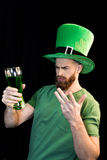 Man holding glass of beer on St.Patrick`s day Royalty Free Stock Photos
