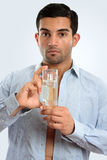 Man holding glass bottle men's cologne Stock Photo