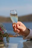Man holding glass with champagne Royalty Free Stock Photography