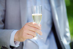 Man holding glass with champagne Royalty Free Stock Photos