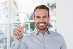 Man holding a glass of champagne Stock Photos