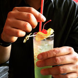 Man holding a glass with cocktail royalty free stock photo