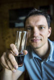 Man holding a glass of dark stout beer Royalty Free Stock Images