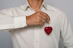 Man holding glass heart Royalty Free Stock Photography