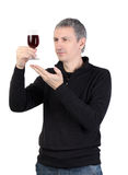 Man holding a glass of red port wine Stock Photos