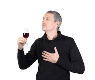 Man holding a glass of red port wine Royalty Free Stock Photography