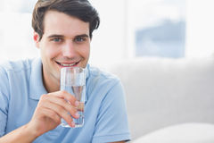 Man holding a glass of water Royalty Free Stock Image