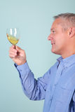 Man holding a glass of white wine Stock Image