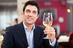 Man holding a glass of wine Royalty Free Stock Images