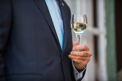 Man holding a glass of white wine Royalty Free Stock Photo