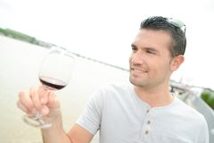 Man holding glass wine. Man holding a glass of wine Stock Photo