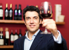 Man holding a glass of wine Stock Photography