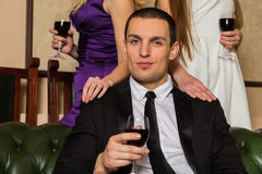 A man holding a glass of wine Royalty Free Stock Image