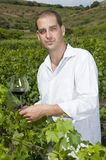 Man holding a glass of wine in a vineyard Royalty Free Stock Photos