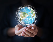 Man holding global in hands Stock Photos