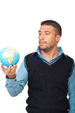 Man holding a globe Stock Images