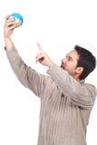 Man holding a globe Stock Image