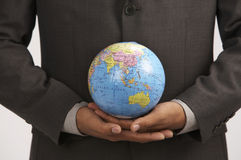 Man holding globe Stock Photography
