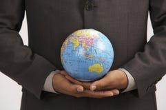 man holding globe stock photography
