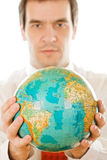 Man holding the globe Royalty Free Stock Images