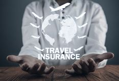 Man holding globe with airplanes. Travel insurance stock images