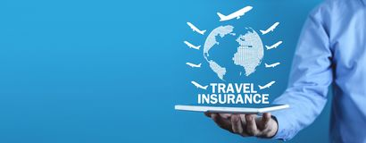 Man holding globe with airplanes. Travel insurance royalty free stock photography